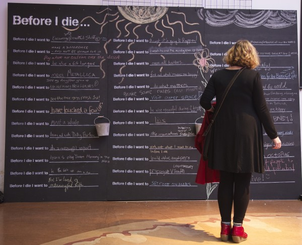 Woman standing in front of chalk board at Meaning Conference  - photo by Clive Andrews / Meaning
